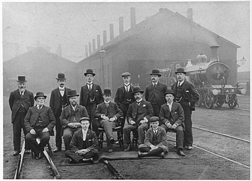 Group of railway men in station yard